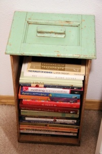 Repurpose and old drawer into a vintage-looking bookshelf.