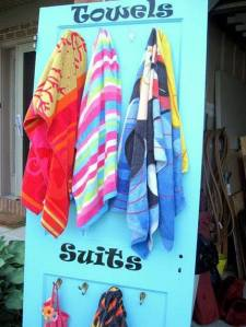 Use a door as a place to keep wet towels and swimsuits.